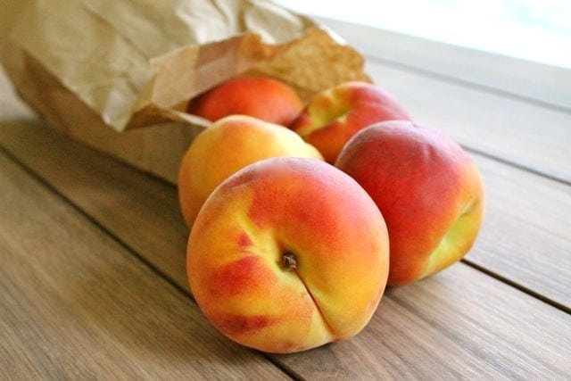 peaches in paper bag