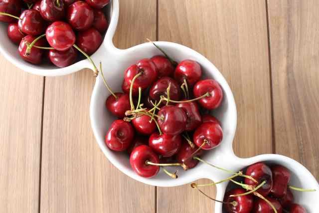cherries in white bowls