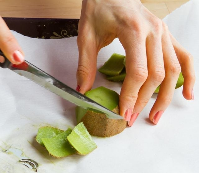 chopping kiwi