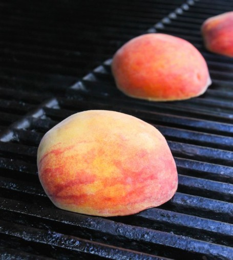 Grilling peaches on bbq