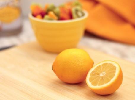 sliced lemon and fruit bowl
