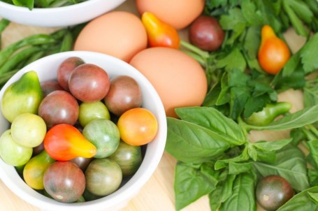 heirloom tomatoes greens eggs and herbs