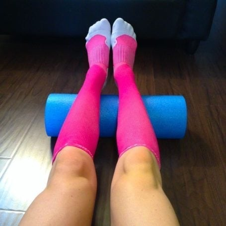 pink tommie copper compression socks and foam roller
