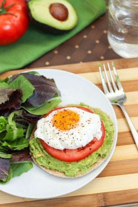 sprouted grain Ozery One Bun with avocado tomato and poached egg