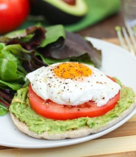 sprouted grain Ozery One Bun with avocado tomato and poached egg 3