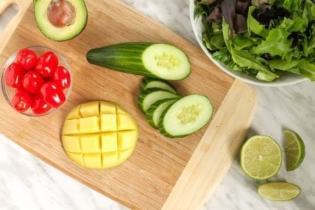 tomatoes avocado cucumber mango and greens