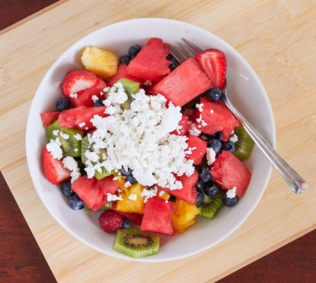 fruit salad topped with cottage cheese