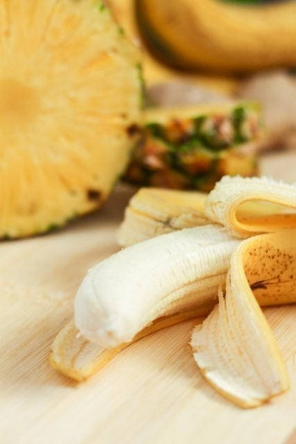peeled banana and pineapple