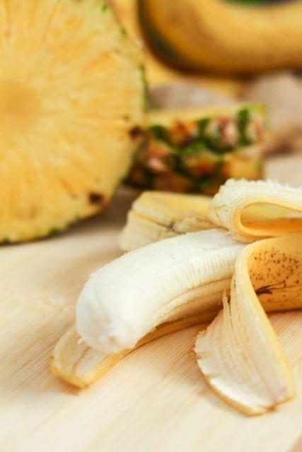 peeled banana and pineapple