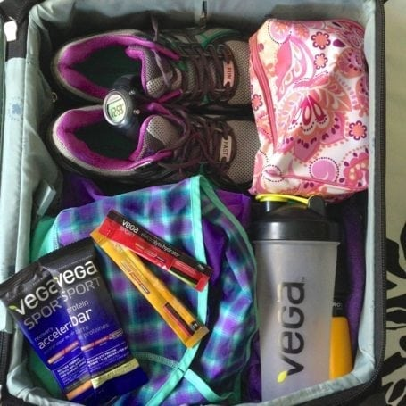 suitcase packed with race essentials