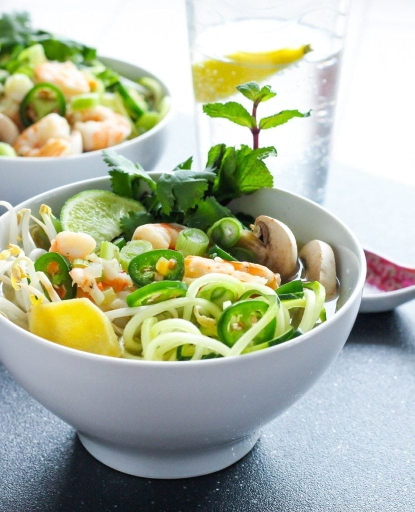 Try this high-protein, cozy Zucchini Noodle Shrimp Pho made with soothing, flavourful broth, fresh herbs and spiralized zucchini. It's paleo and Whole30 friendly too! #paleo #whole30