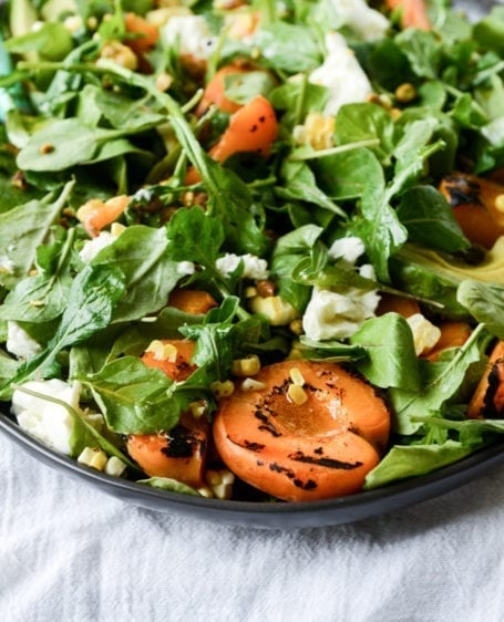 Grilled Apricot, Corn and Arugula Salad - via How Sweet Eats
