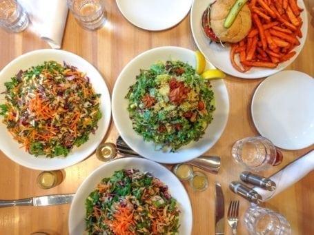 Kale slaw, kale caesar, veggie burger, yam fries - Heirloom Vegetarian Restaurant