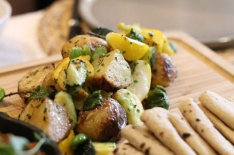 Roasted summer squash and blossoms, hay smoked warba potatoes, and wild green chimmichurri - Forage Vancouver