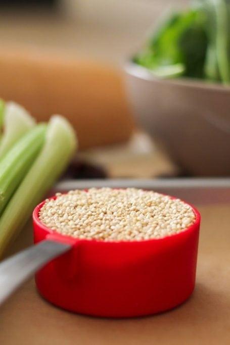 dry quinoa in measuring cup