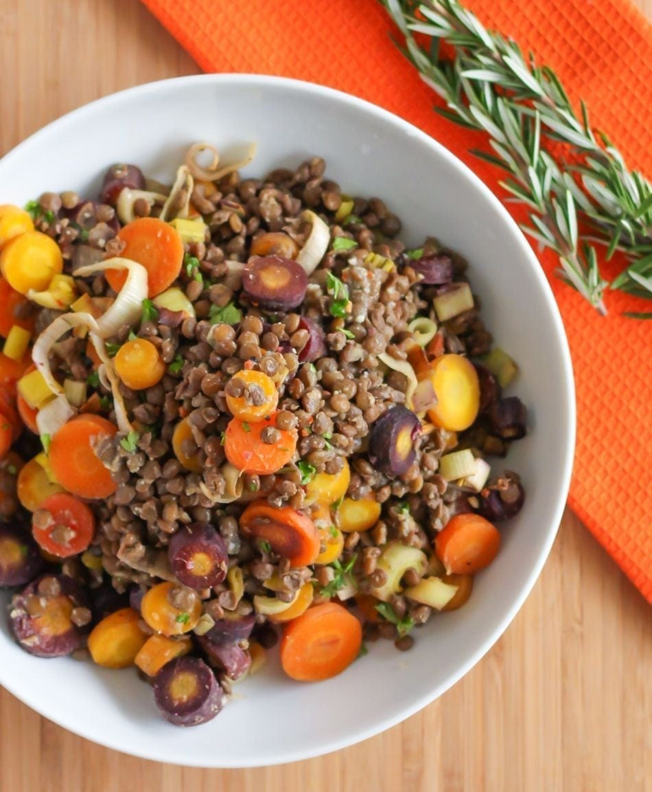 This Rosemary Rainbow Carrot and Lentil Salad is a perfect way to showcase some of fall's best produce! Lentils provide plant-based protein and iron, making this dish satisfying and packed with nutrition benefits. #vegan #thanksgiving #vegetarian #lentils