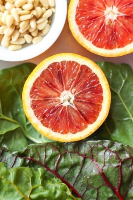 sliced blood oranges and swiss chard
