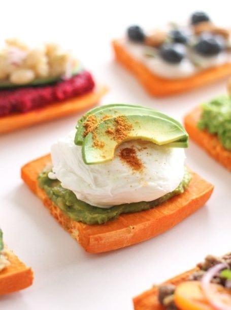 avocado poached egg and guacamole sweet potato toast - eat spin run repeat