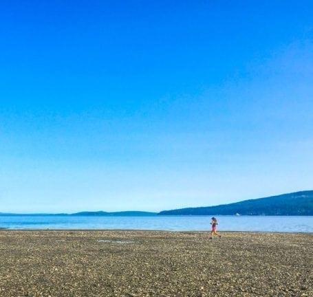 running along the beach in salt spring
