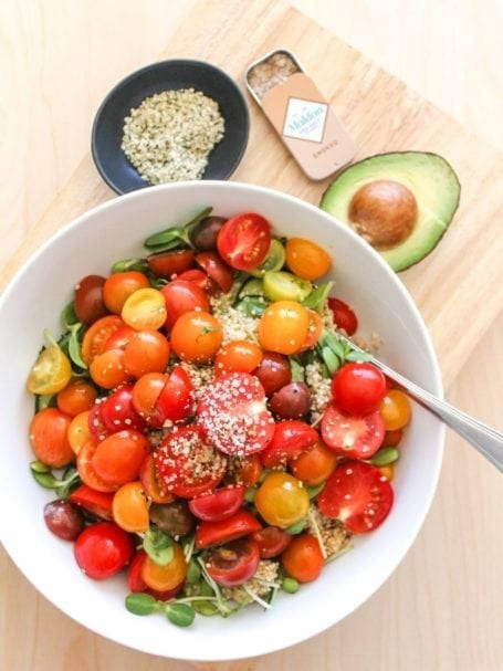 mixing ingredients for Baby Heirloom Tomato, Cucumber and Quinoa Salad - Eat Spin Run Repeat