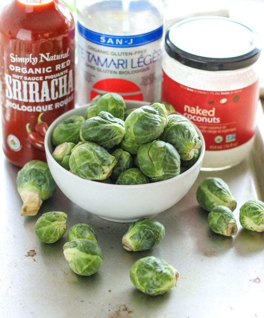 Crispy, spicy and nutrient-packed these Spicy Sriracha Brussels Sprouts with Almond Butter Dip are a strangely addictive snack. Gluten-free, paleo and vegan! #glutenfree #thanksgiving #paleo #vegan #eatclean