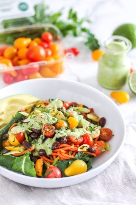 Southwestern Sweet Potato Noodle Bowl - A vibrant mixture of nutrient-packed veggies, fibre and protein-rich black beans, juicy sweet tomatoes, and a super creamy cilantro avocado dressing. Vegan and gluten-free! Recipe via Eat Spin Run Repeat