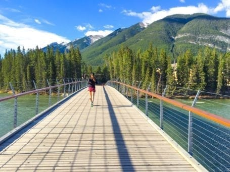 Running over the bridge in Banff