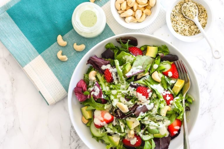 Strawberry Avocado Salad with Hemp Tahini Dressing - A bright and sunny salad for summer, loaded with superfoods and tossed in a creamy, dairy-free tahini hemp dressing. Pair it with your protein of choice for a complete meal. Recipe via Eat Spin Run Repeat // @eatspinrunrpt