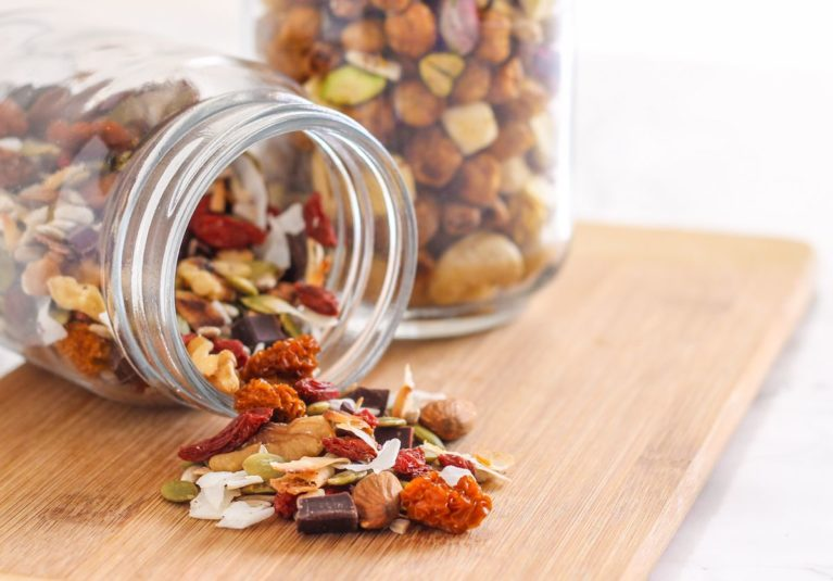 Often the convenient portable snacks we choose tend to be on the sweet side, like protein bars and energy bites. While they seem to be a healthy choice, those grams of sugar can creep up. Whether you're craving sweet or savoury, here are two DIY trail mixes - Health Nut's Indulgence and Taj Mahal Mix - both of which have less sugar than many store-bought options. Recipes via Eat Spin Run Repeat // @eatspinrunrpt