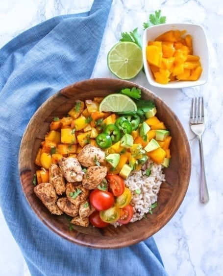 Zesty, spicy, sweet and super fresh, these Mango Jerk Chicken Bowls might soon become a healthy dinner time favourite. Serve with rice, or cauliflower rice to make it paleo-friendly. || Eat Spin Run Repeat