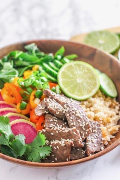 Healthy Korean Beef Bulgogi with Kimchi Cauliflower Fried Rice   #paleo #glutenfree #grainfree   Recipe by Angela Simpson, Culinary Nutrition Expert + Blogger at Eat-Spin-Run-Repeat.com