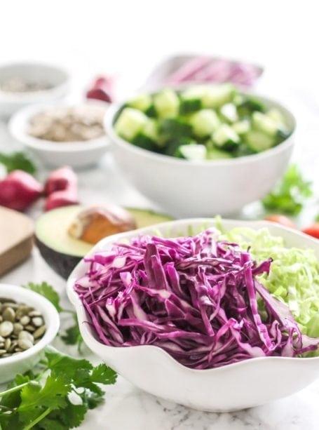 Fish Taco Bowls with Chimichurri Sauce | Angela Simpson, Eat Spin Run Repeat | #paleo #mealprep #pescetarian #eatclean