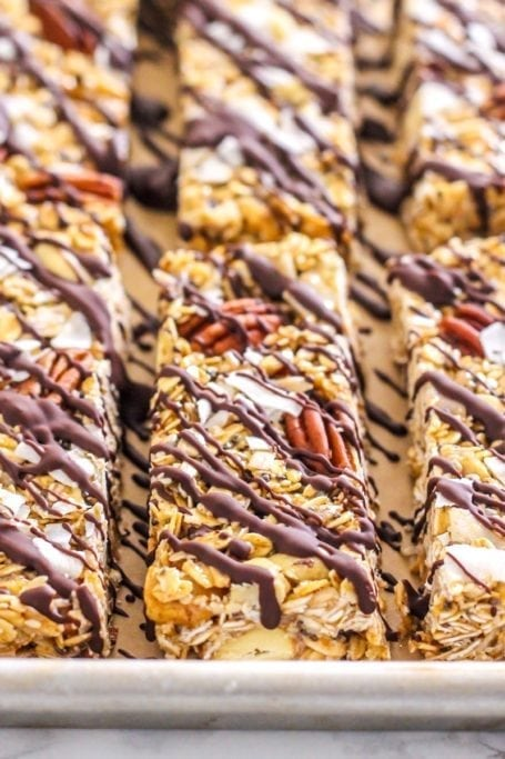 Full of nuts and seeds (and plenty of healthy fats!) theseMaca Cashew Coconut Trail Mix Bars are a delicious rest stop treat when you're on a hike (or just in need of a quick and healthy snack!)   Angela Simpson, Eat Spin Run Repeat   #glutenfree #chocolate #vegan #adaptogens