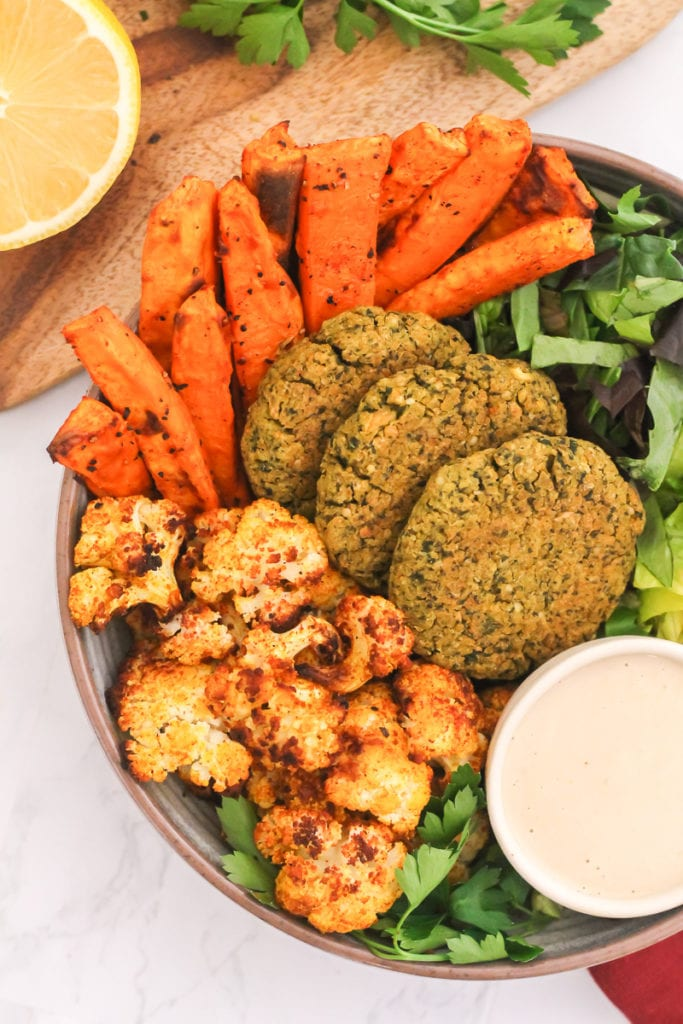 Lemon and Herb Falafel Bowls with Tahini Dressing   These healthy baked falafels work just as great in a buddha bowl as they do as an on-the-go snack!   My Fresh Perspective   #vegan #vegetarian #plantbased #glutenfree #mealprep