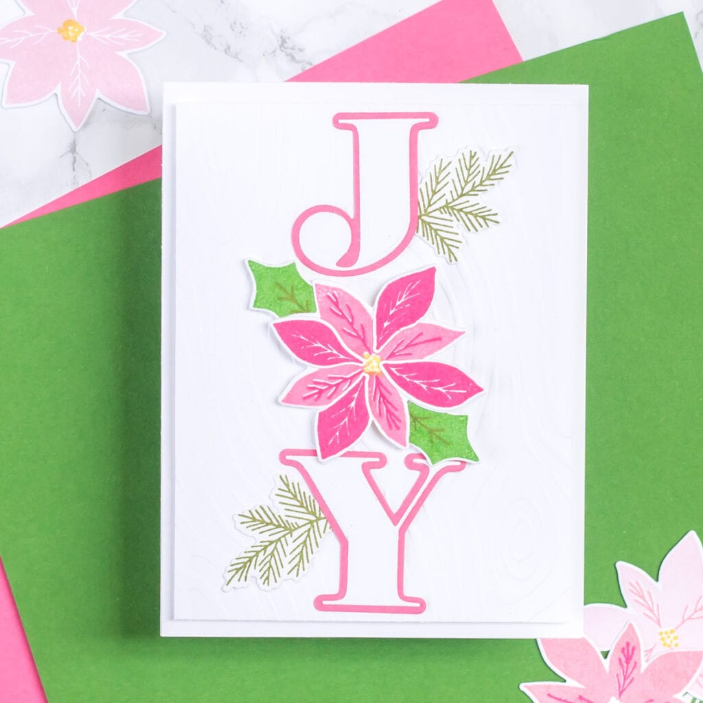 A handmade holiday card featuring The Stamp Market Pointsettia stamp set and coordinating dies